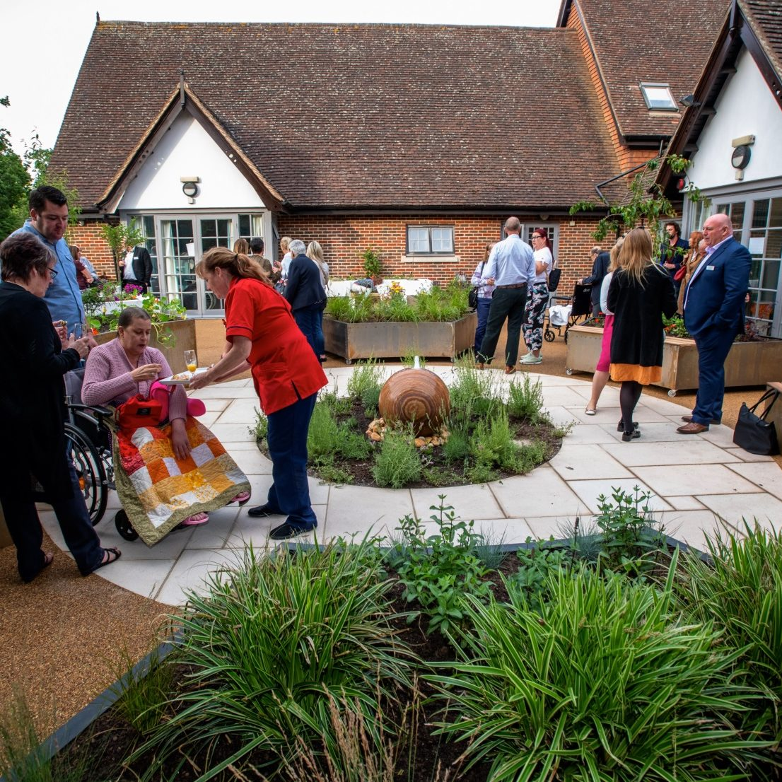 Staff, nurses, patients, and friends in the sensory garden
